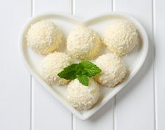 Coconut snowball truffles on heart-shaped plate