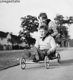 Boys playing with a home-made go-kart, Horley, Surrey, 1965.