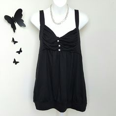 """Sleeveless Jewel Accent Top Cuteness! This black sleeveless top has a cinched bust, three jewel accent buttons, and a banded bottom. Material is polyester / rayon blend.  Size is 2X - Runs small. Bust: Approximately 44"""" Length: Approximately 27""""  New with tags. Extra Touch  Tops"""
