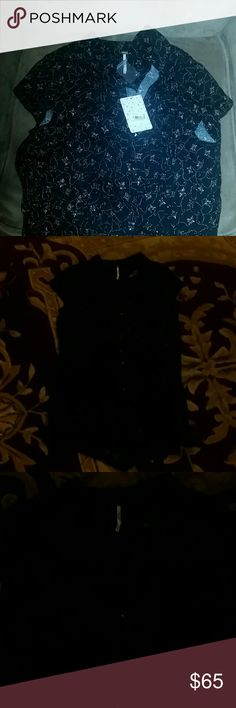 Free people floral collar button down romper Nwt size small free people black and floral romper with collar and very short sleeves. True to size buttons up and is super cute for fall. Smoke and pet free home. Free People Dresses Mini