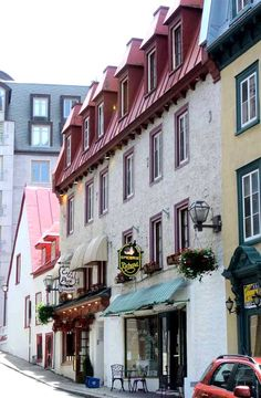 """Quebec City, Canada  """"We spent most of our time in the old part of town which is filled with colorful homes and small hotels with European flair, the architecture featuring dormers, lanterns, and window boxes aplenty."""" Centsational Girl"""