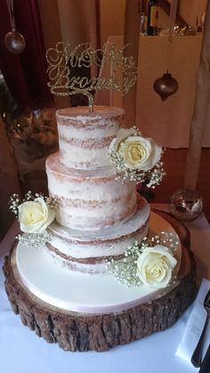 3 tier Semi Naked wedding cake with fresh roses & gypsophilia and gold glitter topper