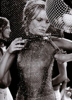Kate Moss backstage at Alexander McQueen SS 1999.  A sparkle at every intersection in a highly geometric look.