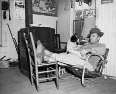 L.V. Darsey lounges with his dog at the roadside filling station and grocery store (1954). | Florida Memory