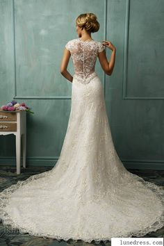 mermaid wedding dress •• http://www.weddinginspirasi.com/2014/01/10/bridal-trends-2014-wedding-dress-details-part-1-illusion-sleeves-necklines-backs/