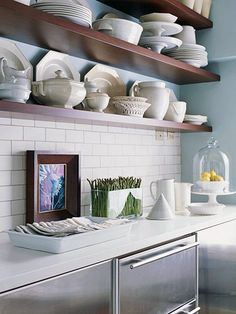BHG OPEN SHELVES i love the styling in this kitchen...the lemons under glass, the dishes chosen for their shapes...