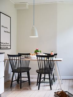 Black chairs, white trestle table