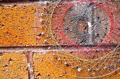 Clear Spirograph on Brick Wall