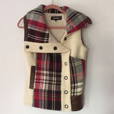 Plaid & Leather Vest From Icelandic brand BIRNA, unique style. Thick wool with brown leather trims and down panels. Dark pink plaid, wide pockets with snap buttons, adjustable sides. Lined on inside for warmth. Size small but fits large (can be worn over thick sweaters too). Worn briefly but no signs of wear! BIRNA Jackets & Coats Vests