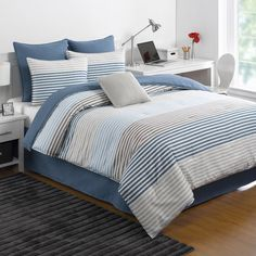 The IZOD chambray stripe comforter Set adds a soft and serene touch to any bedroom. Constructed of a cozy cotton-polyester blend with a 100% polyester fill, the set showcases cascading blue and grey stripes over a crisp white background. Include matching pillow shams and a blue cotton polyester blended bedskirt.
