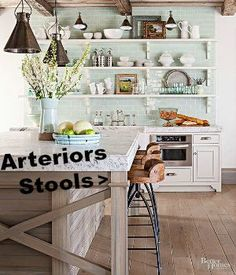 Hinkley Wood and Iron Swivel Bar stools from Arteriors look fabulous!!  As seen in Better Homes & Garden magazine