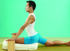 Propped yoga Poses to open stiff hips.