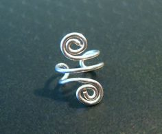 "No Piercing Sterling Silver Handmade Helix Cuff Ear Cuff ""Spiral Up"" 1 Cuff. $8.00, via Etsy."