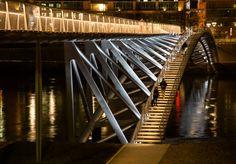 """A new bridge for pedestrians and cyclists over the Rhone in Lyon – """"La Passerelle de la Paix"""" – reveals the landscape and urban changes in the region. Bridge Structure, Timber Structure, Arch Bridge, Pedestrian Bridge, Steel Bridge, Wood Bridge, Bridge Construction, Bridge Design, Architecture Details"""