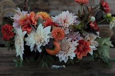 October centerpiece with dahlias, zinnias, and persimmons.  Grown and designed by Love 'n Fresh Flowers.