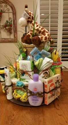 How to Make Baby Diaper Cake - Jane - How to Make Baby Diaper Cake Jungle theme diaper cake - Baby Shower Diapers, Baby Shower Fun, Baby Shower Cakes, Baby Shower Themes, Shower Ideas, Jungle Theme Baby Shower, Jungle Nursery Boy, Baby Boy Themes, Baby Shower Presents