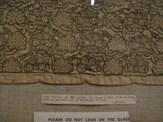 English coif, late 16th century. Victoria and Albert Museum, London. Label reads: gilt thread in chain stitch on linen with cut and drawn work and needlepoint fillings. (I'd not be surprised if this is later, but I am not an embroidery expert by any stretch.)