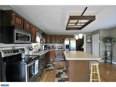621 S Hanover Street- Pottstown PA located close to 422 this great home offers a wonderful deck and great kitchen! Hanover Street, Kitchen Island, Deck, Table, Furniture, Home Decor, Island Kitchen, Decoration Home, Room Decor