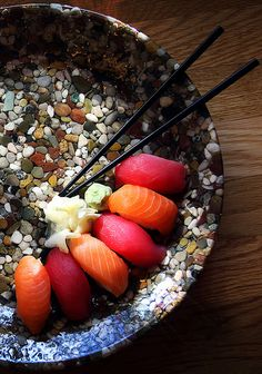 Christie Gardner :sushi on the rocks (this is a plate made of actual stones in a resin. Was purchased from the MOMA gift shop in NYC many years ago)
