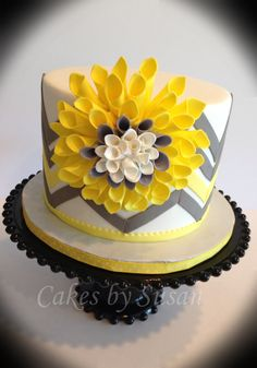 Yellow and gray chevron cake. I saw this flower made...