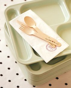 Vintage lunch trays were for guest to collect their dinner cafeteria-style. The wooden utensils were hot-stamped with the couple's names, and paper napkins were rubber stamped with the date.