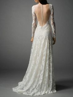 Elegant lace wedding dress with long sleeves and illusion plunging neckline and illusion open back.  Processing TimeStandard processingtime is approx 8 weeks,