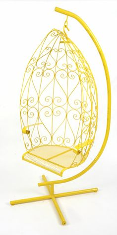 Incredible canary yellow metal hanging chair circa early 1970′s. Features wonderful scroll detailing and perforated metal seat. Can also be used indoors or out because of its resilient powder coated finish
