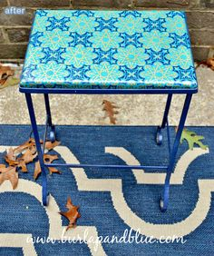 blue_outdoor_table_makeover  patio table recovered in wrapping paper and modge podged!