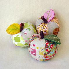 Apple pincushion ~ inspiration only but those felt stems & leaves are darling additions to the mod apples .....