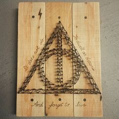 """""""It does not do to dwell on dreams and forget to live."""" Helped @nikkicraft with her #HarryPotter themed string art! She did most the work! #stringart #pallet #wood #HarryPotter #nerdy"""