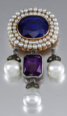 GEM-SET AND DIAMOND BROOCH The surmount of cluster design centring on an oval sapphire within borders of seed pearls, suspending three drops accented with rose-cut diamonds terminating on cultured pearls, the central pendant set with a mixed-cut amethyst, composite.