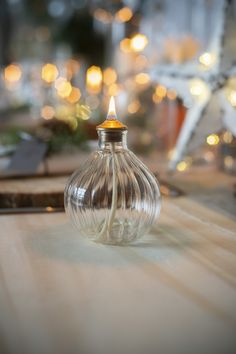 Ideal as a gift, this glass oil lamp is a pretty and functional piece with hand blown glass and an antique brass topper that will light up any room. Natural Lamps, How To Clean Brass, Modern Properties, Natural Building, Oil Lamps, Hand Blown Glass, Metal Working, Light Up, House Warming