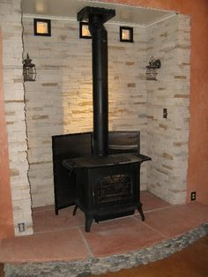 Step Top Quadra Fire Stove In Stoned Alcove And Tile