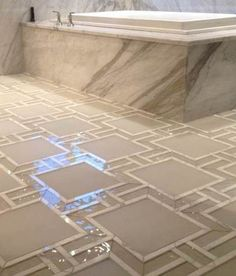 stone and glass bathroom floor