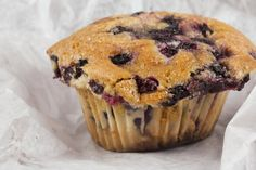 Although the ingredients for Jordan Marsh Blueberry Muffins don't seem magical, the abundance of berries that turn the batter a pale lavender and a sugary topping can transport you back in time.