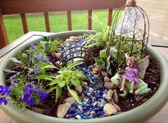 Here's the beautiful fairy garden my momma made for me and we embellished together- what a fun, relaxing project!!!