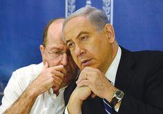 Prime Minister Binyamin Netanyahu, right, confers with Defense Minister Moshe Ya'alon. Photo By: HAIM ZACH/GPO