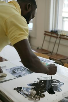 Chris Ofili in the studios at Two Palms painting on Mylar for the portfolio Black Kiss