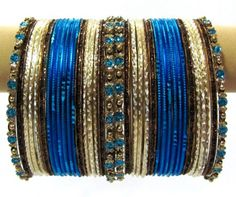 Blue Cream and Antique Color Indian Bangles set of 36 Belly Dance Costume Bracelets Product Code :Indian Bangles Set 53 The Bangles Set Contains 36 individual Bangles Colors & Design: (As Per Images) Quantity: 1 Bangles Set Base Material : Alloy Metal Decorated with Glitter Dust and Age Group : Adult,Kids Price $USD   9.99