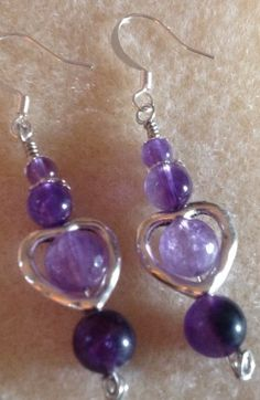 These are wire wrapped earrings. I made the headpins with knotted ends.