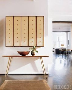 Steal this look! Do you have a nook that needs a bit of Oscar-worthy style? Follow the lead of acclaimed actress Julianne Moore. She paired a petite area rug with an eye-catching console in her West Village loft to create a trendy statement in her hallway.  (Photo via Elle Decor)