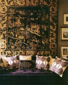 Deep purple velvet, gorgeous ikat print pillows and scenic art hanging