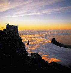 "you see this..... Cape Town sunset with Table Mountain covered by the cloud ""table cloth"""