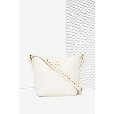 White Noise Studded Vegan Leather Bag ($48) ❤ liked on Polyvore featuring bags, handbags, shoulder bags, ivory, bucket handbags, vegan purses, nila anthony handbags, vegan handbags e studded handbags