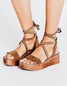 Jesus sandals but with the chunky platform of today... ?