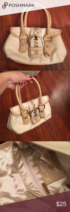 United Colors of Benetton mini bag In excellent condition. Goes with any day or evening outfit. See last pic that show tiny marks on bottom and the front belt cloth is a little smudged but can't tell. Ask for more photos and details. Will only trade if I see something I really like. United Colors Of Benetton Bags Mini Bags