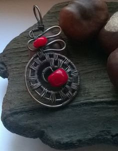 Allusion Pendant  I offer you this handmade pendant made of copper and red coral.  You will receive this pendant in a handmade box. Would you like to