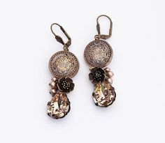 Glass button earrings, a one of a kind design, romantic Gypsy/Boho and Victorian inspired, made with stunning, intricate, gold gilded, raised floral pattern, vintage glass buttons, set in Vintaj antique bronze brass filigree. The dazzling Swarovski Silk (a pale neutral tone) crystal drops are set in top quality brass settings. Between these two elements are wirewrapped Swarovski Powder Almond crystal pearls, and a beautifully detailed antique brass blossom. These earrings would be so…
