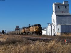 An eastbound UP train passing one of the feed mills in Norway, IA.