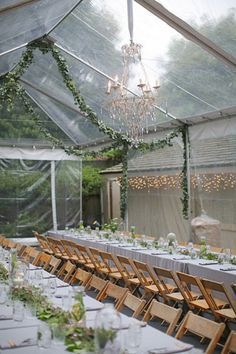 #chandeliers #tent tables decorated with garland |  Photography by lanedittoe.com |  Bouquets + Garland by flowerwild.com |  Event Design by strychnosmilk.wix.com/thepaperarum |   Read more - http://www.stylemepretty.com/2013/07/10/beverly-hills-wedding-from-lane-dittoe-fine-art-photographs/